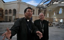 Archbishop John Du (left) and Cardinal Theodore McCarrick, president of Catholic Relief Services check damage to the cathedral in Palo, Nov. 17, 2013.